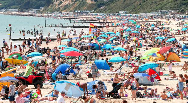 People enjoying the heatwave on Bournemouth beach in Dorset yesterday