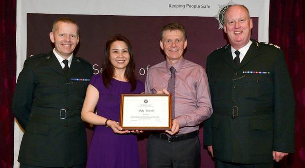 From left: Superintendent Jeremy Lindsay; Ms Amy Chung; Causeway Coast and Glens Borough Council environmental health officer Dr David Allen and PSNI Chief Constable George Hamilton