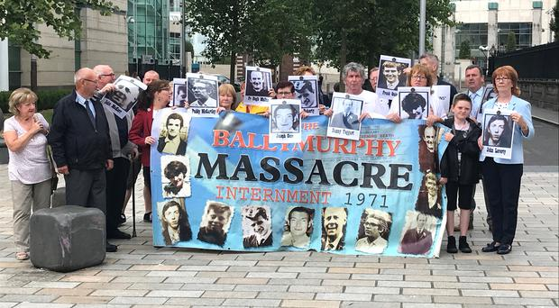 Families of those killed in the 1971 Ballymurphy Massacre protest outside Belfast High Court ahead of an inquest preliminary hearing (PA)
