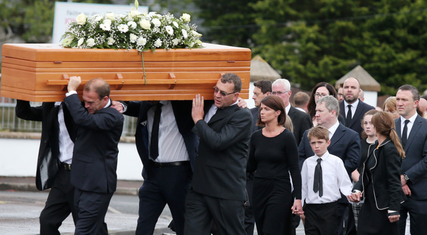 Mourners at the funeral for Henry McStravick in Crumlin on Saturday