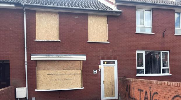 The boarded-up house in Belfast (Rebecca Black/PA)