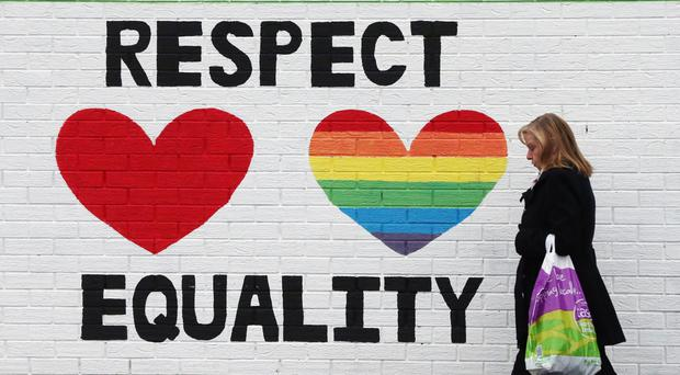 A mural in support of same sex marraige on the Falls Road in Belfast (Niall Carson/PA)