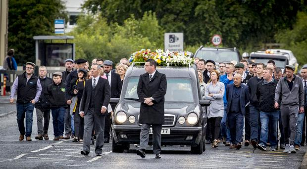 Mourners at the funeral of Brian Phelan in Bessbrook