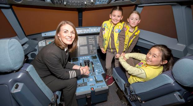 Captain Kate McWilliams in the flight deck at easyJet's training academy as a new aviation badge for Brownies was unveiled as part of a campaign to encourage more girls to become pilots