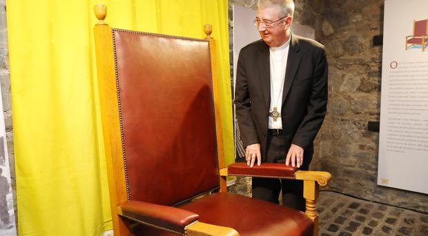 Archbishop Diarmuid Martin with the chair used by Pope John Paul II on his visit to Dublin