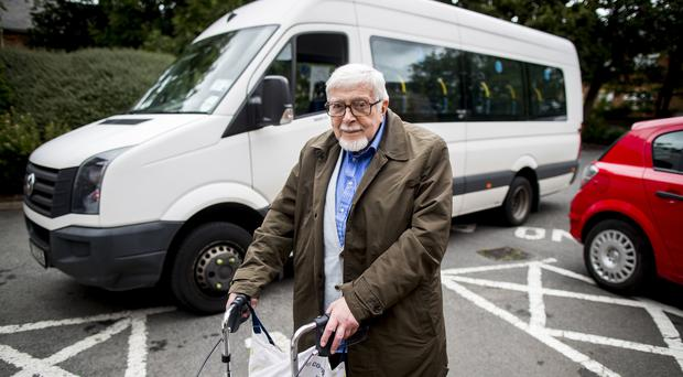 Retired civil servant Hilary Connolly, 82, from Belfast using a door-to-door service for those with mobility problems (Liam McBurney/PA)