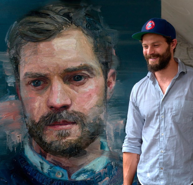 Jamie Dornan with the painting by Colin Davidson