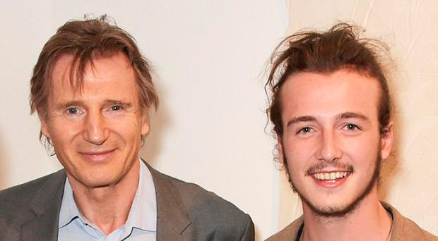Micheal Richardson with dad Liam Neeson at a Soho gallery launch