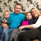 Sophia Gibson with her parents Darren Gibson and Danielle Davis and brother Mason