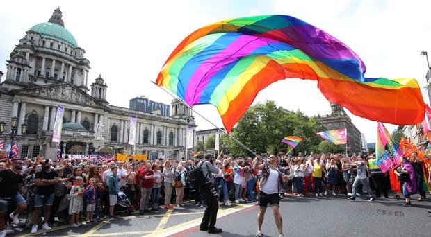 Marchers and the public at the annual Belfast Pride parade