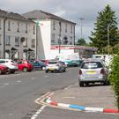 Flags flying in Limavady and kerbs painted red, white and blue or green, white and orange
