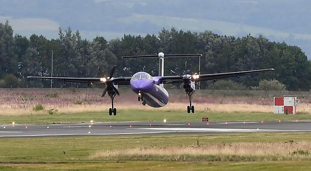 The Flybe flight from Glasgow landing with one engine at Belfast City Airport (right side engine failed)