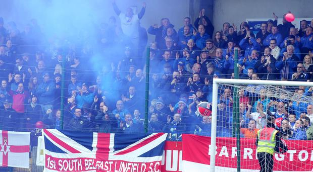 Linfield fans at the north Belfast home of rivals Cliftonville
