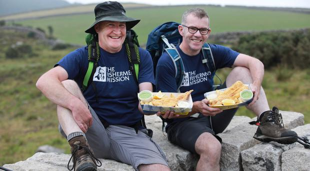 Alan Hanna (left) and Malachy Mallon take a break from training in the Mourne Mountains for their bid to scale Kilimanjaro