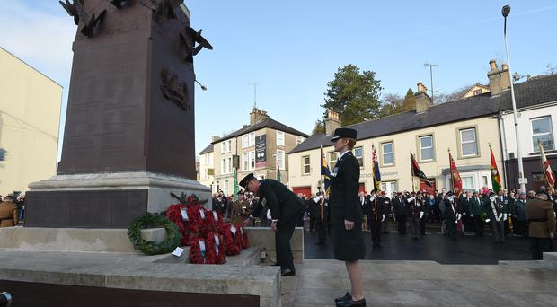 Chief Constable George Hamilton and District Commander Superintendent Jane Humphries lay wreaths at the war memorial during events to remember the 12 victims of the IRA's 1987 Remembrance Sunday bomb attack in Enniskillen, Co Fermanagh (Phil Fitzpatrick/PA)