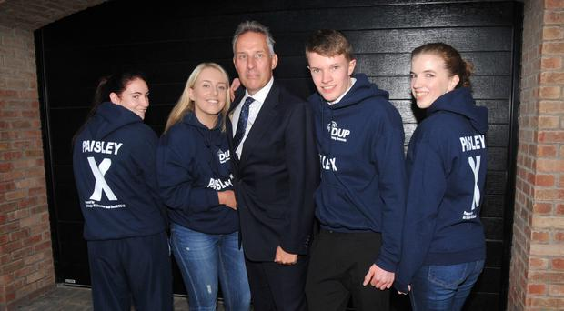 Clockwise from top: North Antrim MP Ian Paisley with some of this young supporters (including his daughter Emily, second from left) last night