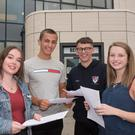 Laura Hegarty, Matthew Austin, Jason Pollock and Erika McClelland celebrate after receiving their A-level results