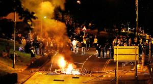 Crowds gather during disturbances on Fahan Street in Derry last month