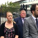 Family of Debbie Whyte with solicitor Matthew McKenna outside Belfast Coroner's Court (David Young/PA)