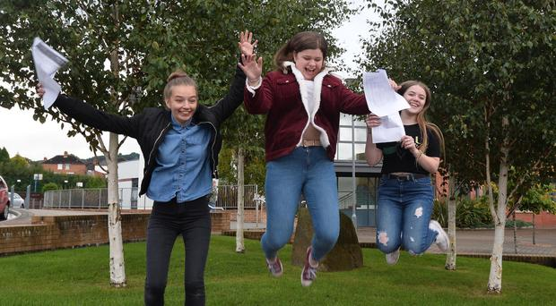 Martyna Zaborowska, Chantelle Wishart and Hollie Ferguson receive their results at Girls Model in Belfast