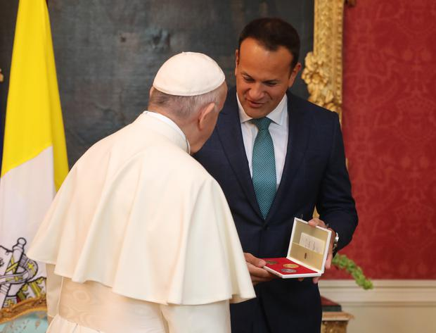 Pope Francis presents Taoiseach Leo Varadkar with a gift (Niall Carson/PA)
