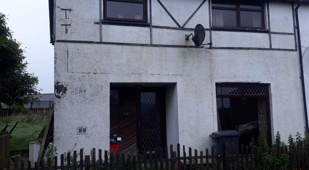 A man escaped injury after a viable explosive device was found outside a house in Carrickfergus