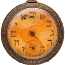 The watch has numerals in Hebrew and embossed design featuring Moses