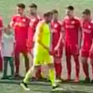Reds snub: Roy Carroll (in the yellow kit) walking past Cliftonville players on Saturday
