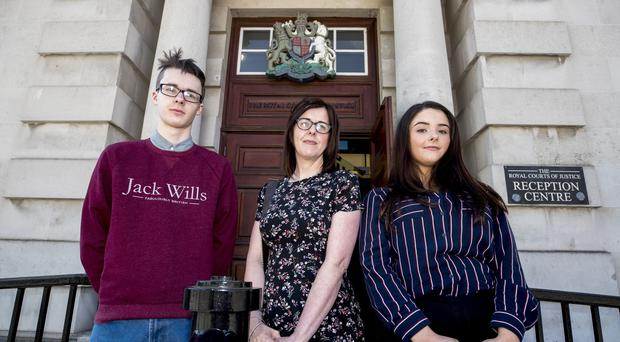 Siobhan McLaughlin, who won her court fight, with her children Billy and Rebecca Adams (Liam McBurney/PA)