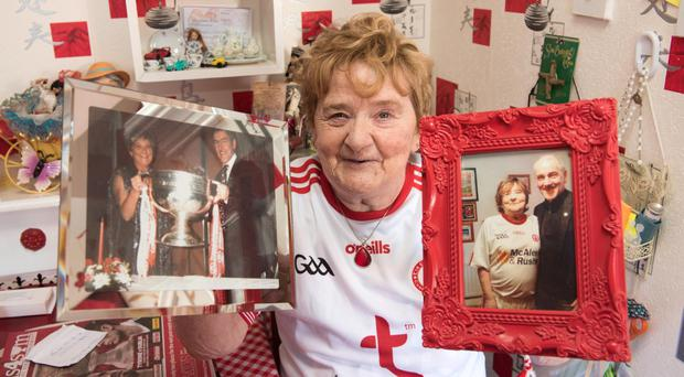 Superfan Mary McAleer with cherished pictures of Tyrone manager Mickey Harte