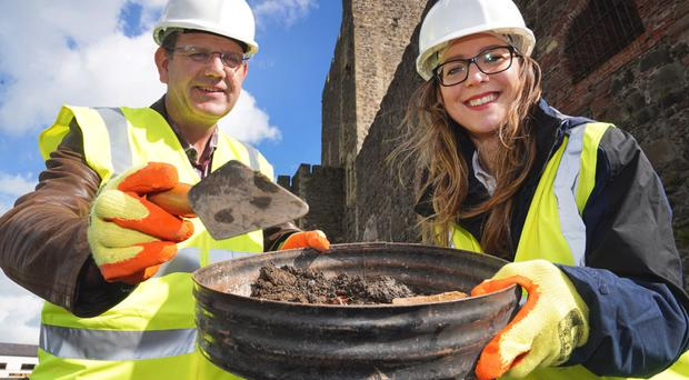 Archeologists Dr Chiara Botturi and Dr John O'Keeffe from the Department for Communities who are managing the project at Carrickfergus Castle to re-open a Victorian tunnel