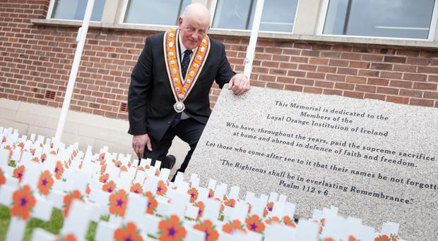 Grand Master of the Grand Orange Lodge of Ireland, Edward Stevenson, pays his respects at the Institution's memorial garden