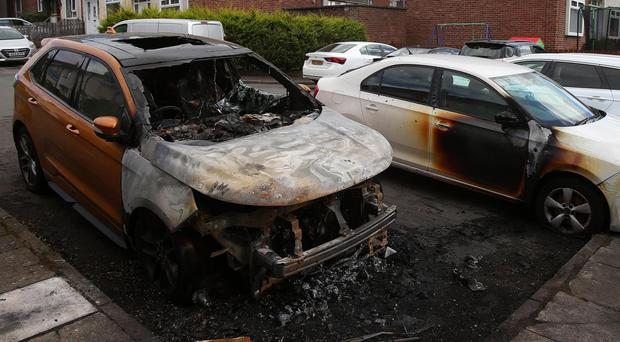 Two of the cars that were damaged in the Riverside area of Dunmurry yesterday