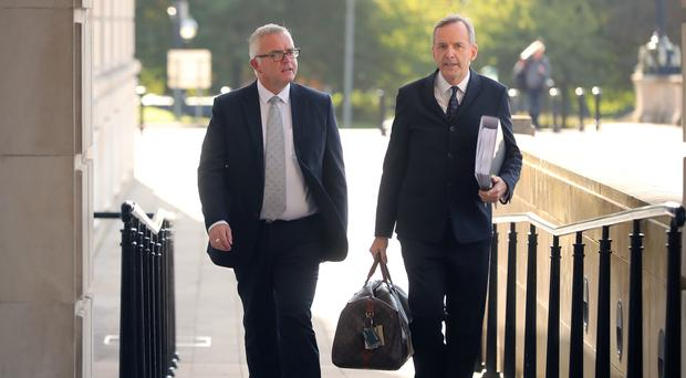 Former DUP minister Jonathan Bell (left) and his solicitor Denis Moloney arrive at the RHI inquiry at Stormont (Niall Carson/PA)