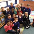 Lorainne Pendleton with the children at Castlereagh Nursery School where she has taught for 40 years