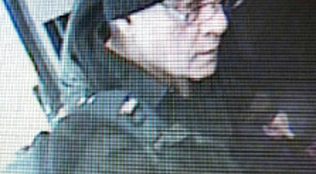 A CCTV image of a man believed to be John Clifford boarding a train in Belfast