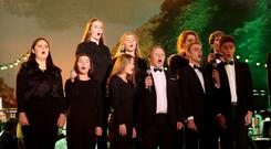 Northern Ireland-born baritone Karl McGuckin with members of The Ulster Youth Choir during Proms in the Park