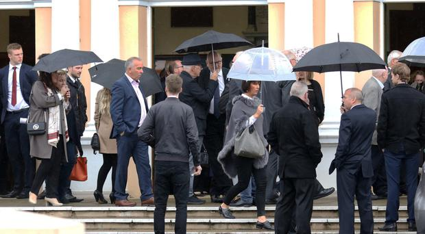 Mourners attend the funeral of Hilary Ferris at Whiteabbey Presbyterian Church