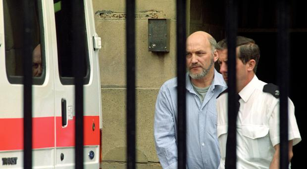 Convicted killer Robert Black is led away from Newcastle Crown Court (John Giles/PA)