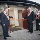 Orange Order grand master Edward Stevenson cuts the ribbon at the official opening of the new hall
