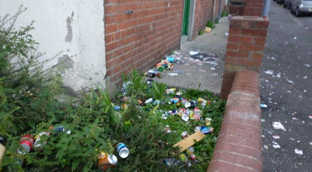 Empty cans and bottles strewn on the streets and houses of the Holylands