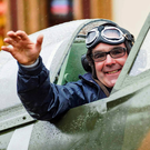 Henry (Harry) Munn waves from the cockpit of the society's 'Down' Spitfire