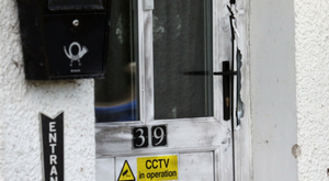 Damage to door at scene of shooting in Ballymoney. Pic by Peter Morrison