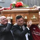 Family and friends of Matt Campbell carry his coffin following the funeral service