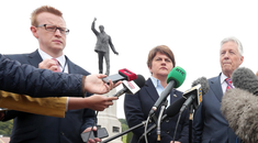 John Robinson with Arlene Foster and Peter Robinson at Stormont in 2015