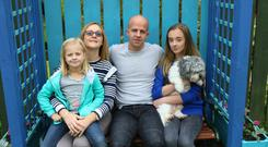 Lee Tavinder and wife Selena with daughters Rachel and Charlotte and their dog Marley