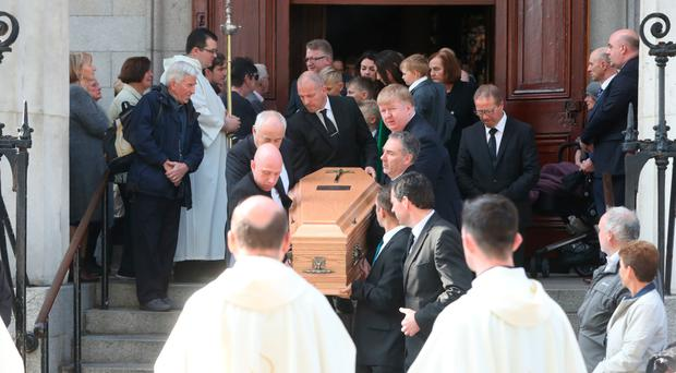 The coffin of Emma Mhic Mhathuna is carried from St Mary's Pro-Cathedral in Dublin following her funeral Mass