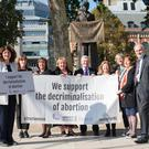Diana Johnson MP (left) who has launched a Private Member's Bill to decriminalise consensual abortion in England, Wales and Northern Ireland, with a cross-party group of MPs and co-sponsors by the statue of Millicent Fawcett in Parliament Square