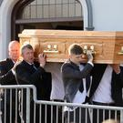 Family and friends carry the coffin of Wayne Bell from St Elizabeth's Church in Moygashel following a funeral service for the young boxer