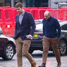 Iain Henderson and Rory Best outside court in January